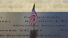Close Up of USA Flag Flying in 911 Memorial Plaque