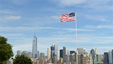 USA Flag Flying in front of New York Skyline